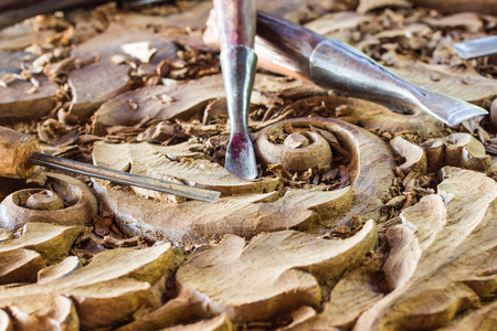 wood carvings: a wood carvings, tools and processes work closeup