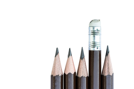pencil eraser: pencil eraser standing out from the row of pencils. Stock Photo