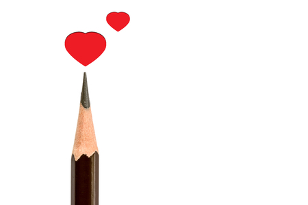 pencil point: Pencil point close-up and red heart on white background Stock Photo