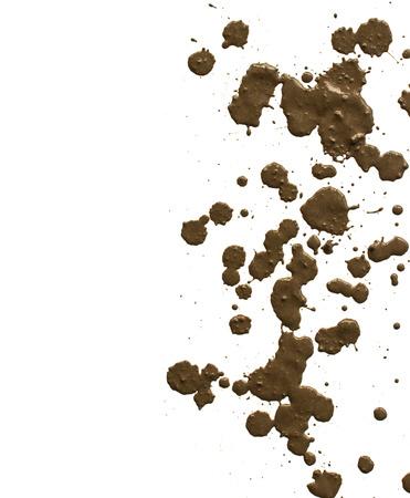 sprayed: drops of mud sprayed a white background