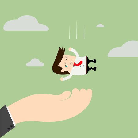 caching: A big hand is caching falling businessman. Consulting, assistance, teamwork