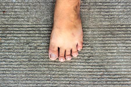 cement floor: Top View of Bare Foot on Cement Floor Background. Walk to the Nature. Relax