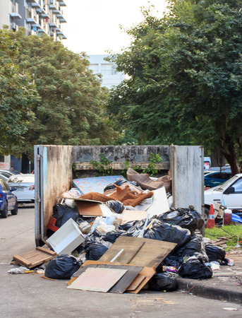 disposed: Dumpsters being full with garbage