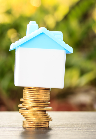 House on a pile of money Stock Photo