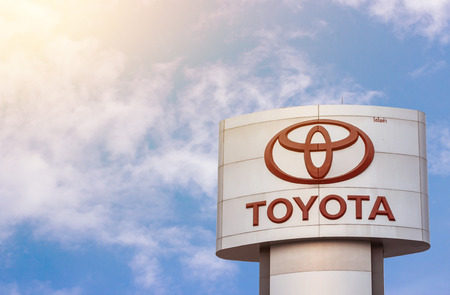 affixed: Phichit, Thailand - February 28, 2016. a banner with the emblem and inscription of the manufacturer of TOYOTA cars affixed to the front of the car dealership to sell cars Editorial