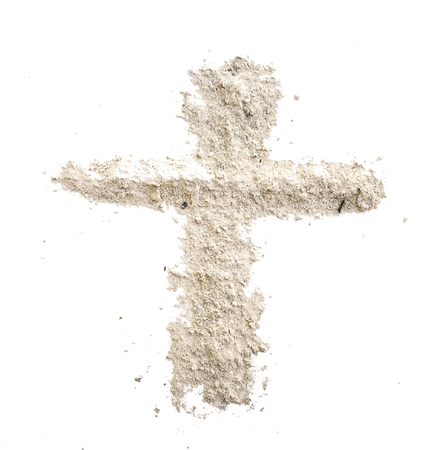 christian cross made in grey ash or dust as grave