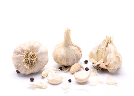 spiciness: Fresh garlic on white background