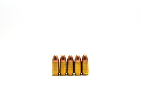 9mm ammo: Five ammunition on white background. Stock Photo