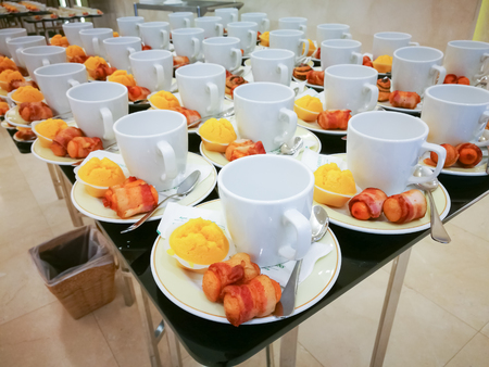 Coffee cups and Bacon, dessert cup on a table
