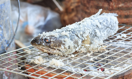 Salt Crusted Grilled Fish. striped snakehead fish.