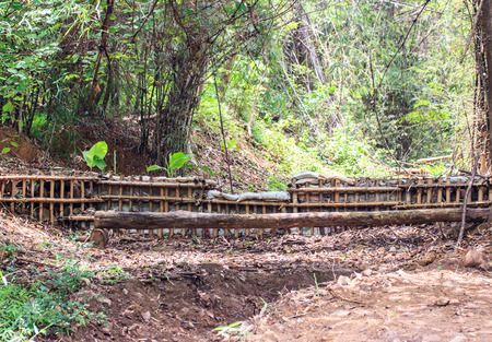 check dam made by local materials; wood, soil, stone etc. in Thailand 写真素材