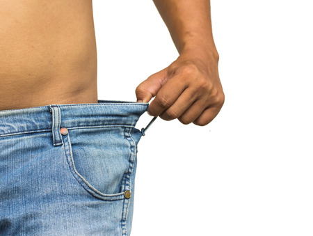 Weight loss, close up of man wearing too large jeans