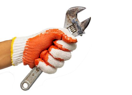 Close up view of a mans hand holding adjustable wrench isolated on white background. Mechanic and repairman. Handyman. DIY concept. Tools and instruments.
