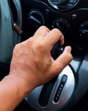 Man Hand on Auto gear available in new cars