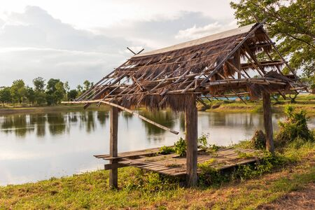 Tropical landscape view of Traditional waterfront wooden pavilion locate nearly lake. Stock Photo
