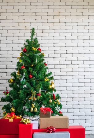 Decorated Christmas tree on blurred, sparkling and white wall background