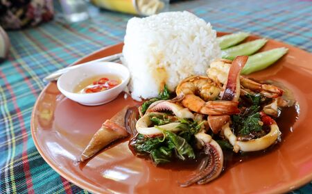 Stir fried sea basil ,Thai food is delicious.With shrimp, squid as the main components And is the local food of Thailand