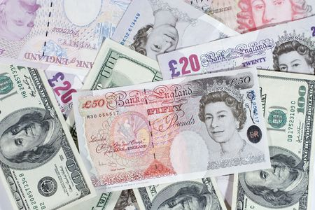 Bunch of twenty-pound notes, fifty-pound notes and one-hundred dollar bills