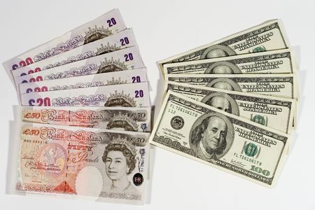Twenty-pound notes, fifty-pound notes and one-hundred dollar bills