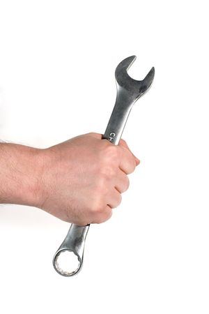Man's hand holding a wrench (against the white background) photo