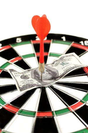 financial target: One-hundred dollar bill on a dartboard