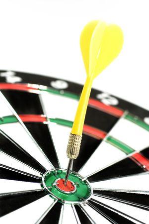 Dart in a dartboard (hitting the bullseye) Stock Photo
