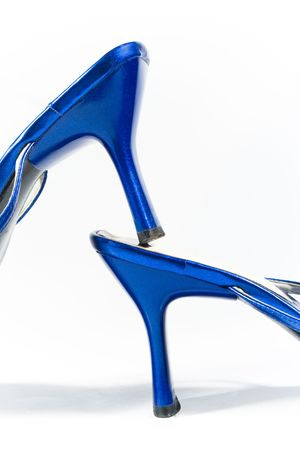 Shiny heels of beautiful blue shoes (on white) Stock Photo