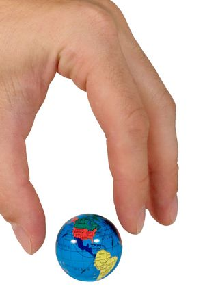 Human fingers ready to seize a small globe (isolated on white) photo