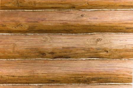 Closeup of an old wooden wall made of logs (as a wooden background) Stock Photo