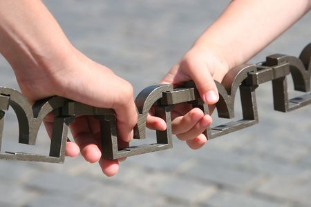 Closeup of hands holding a chain Stock Photo - 3602036