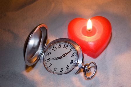 Antique watch covered with sand and red heart-shaped candle Stock Photo - 3622515