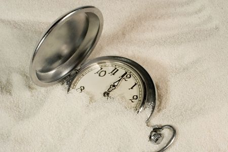 Antique watch covered with sand Stock Photo - 3622529