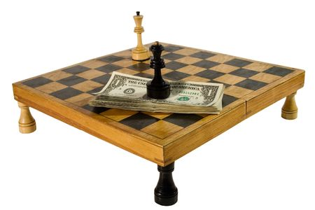 US dollars and chess figures on a chessboard resting upon rooks (isolated on white) photo