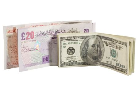 One-hundred dollar bills and British pounds (isolated on white) photo