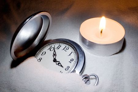 Antique watch covered with sand and a candle Stock Photo - 3661093