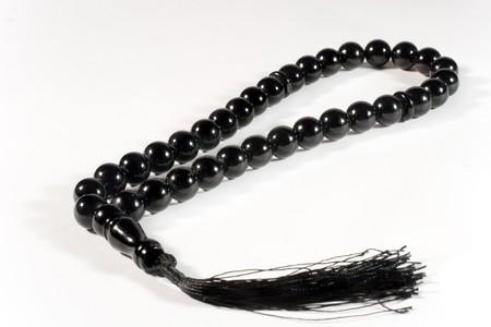 Black prayer beads (on white)