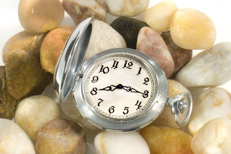 Ancient pocket watch under water (on pebbles) symbolizing the flow of time Stock Photo - 3961103