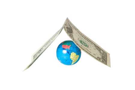 Small globe hiding under the roof (made of a dollar bill), isolated on white photo