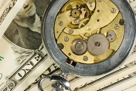 """Old watch mechanism and dollar bills (""""time is money"""" concept) Stock Photo - 3980547"""