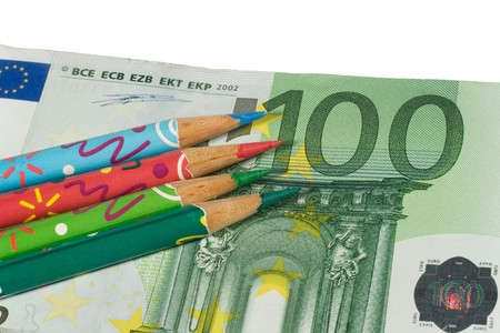 onehundred: Four color pencils on a one-hundred euro bill (isolated on white) Stock Photo
