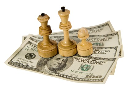 conquest: Chess figures (white king, queen and pawn) standing on US dollars, isolated on white