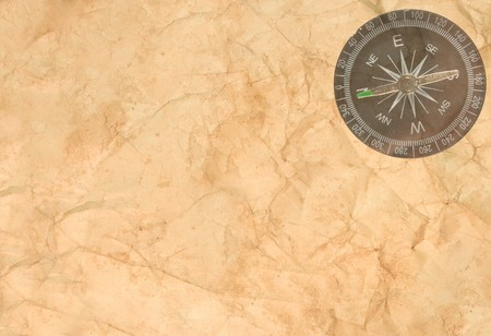 crumple: Old crumpled paper with a transparent compass in the corner