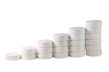 Pile of white pills isolated on white (in the form of a staircase) Stock Photo