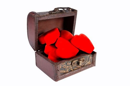 Ancient treasury chest full of red hearts (isolated on white) Stock Photo