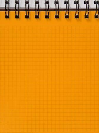 Yellow squared notebook sheet Stock Photo - 5277385