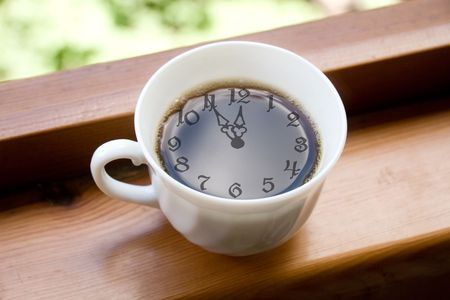 coffee hour: Time for a coffee break (coffee cup with the clock face in the cup of coffee)
