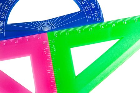 Multicolored rulers and a protractor isolated on white (as an abstract mathematical background) Stock Photo - 5600146