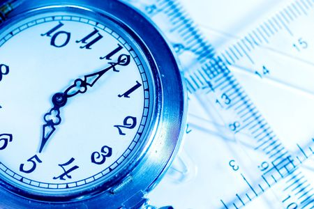 Pocket watch and transparent rulers (symbolizing measurement tools) photo