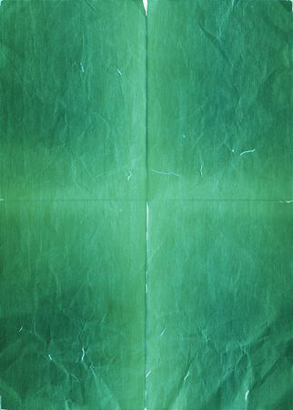 Torn and crumpled green paper (as a background) Stock Photo - 5600536