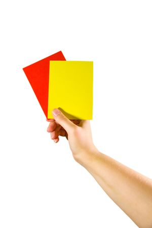 Hand holding red and yellow cards (isolated on white)